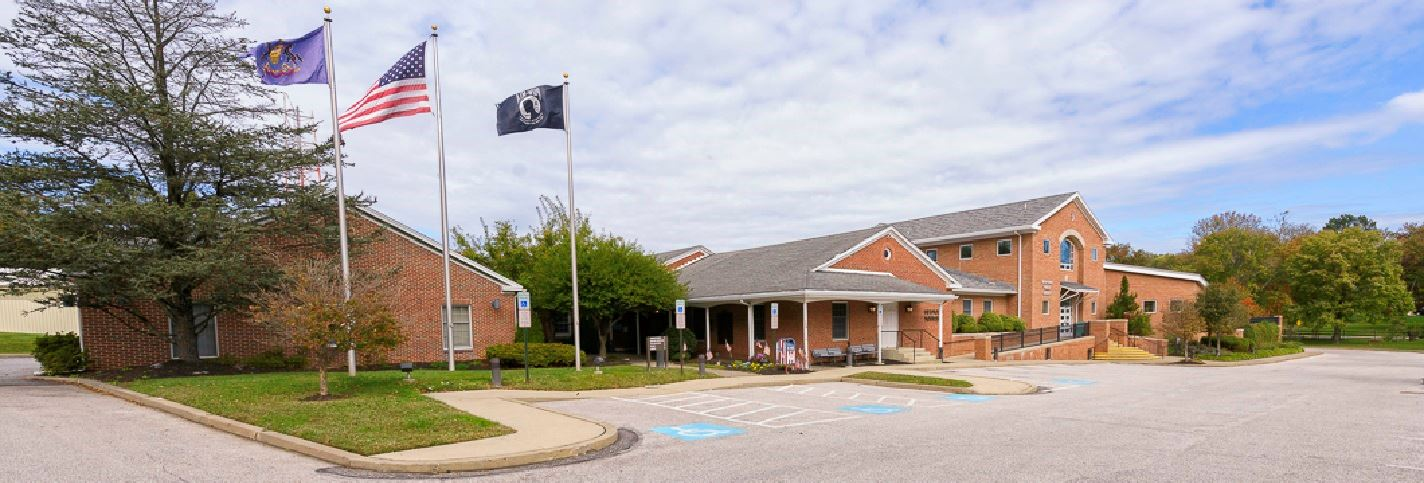 Township Municipal Building with Flags Waving Out Front